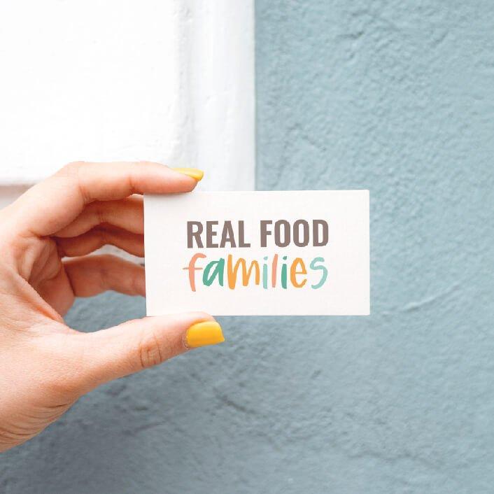 Design mockup of the Real Food Families logo on a card