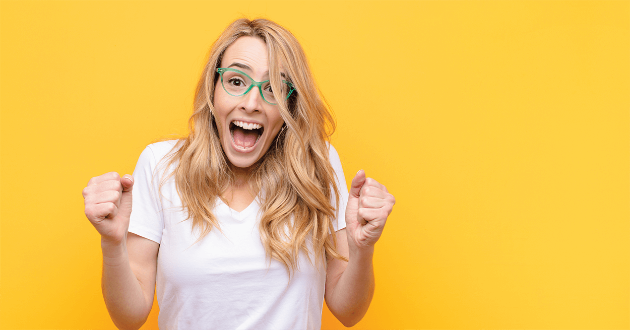 Excited lady on yellow background
