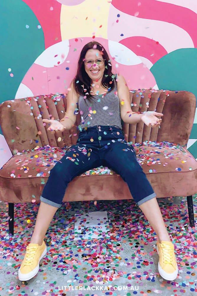 Brisbane illustrator Kat Potter throwing colorful confetti